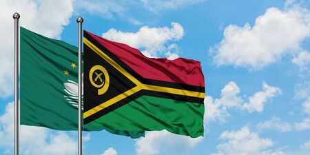 Macao and Vanuatu flag waving in the wind against white cloudy blue sky together. Diplomacy concept, international relations. Stock fotó