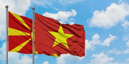 Macedonia and Vietnam flag waving in the wind against white cloudy blue sky together. Diplomacy concept, international relations.