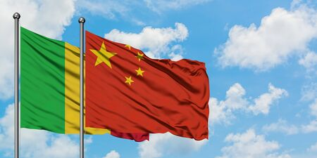 Mali and China flag waving in the wind against white cloudy blue sky together. Diplomacy concept, international relations. 版權商用圖片