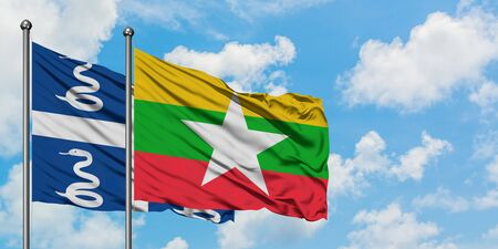 Martinique and Myanmar flag waving in the wind against white cloudy blue sky together. Diplomacy concept, international relations. Stok Fotoğraf