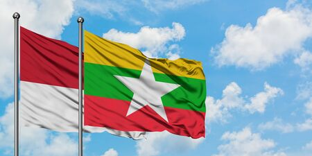 Monaco and Myanmar flag waving in the wind against white cloudy blue sky together. Diplomacy concept, international relations.