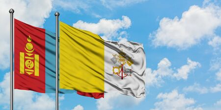 Mongolia and Vatican City flag waving in the wind against white cloudy blue sky together. Diplomacy concept, international relations.