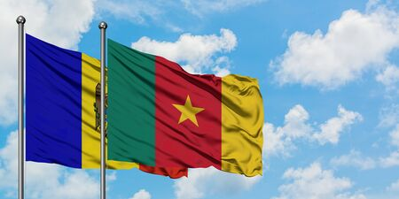 Moldova and Cameroon flag waving in the wind against white cloudy blue sky together. Diplomacy concept, international relations.