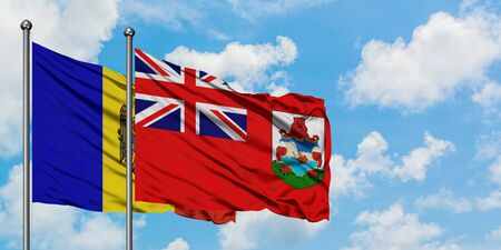 Moldova and Bermuda flag waving in the wind against white cloudy blue sky together. Diplomacy concept, international relations.