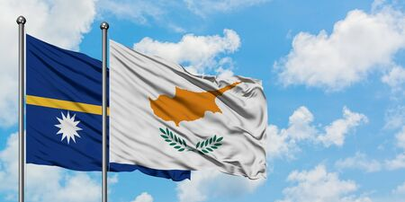 Nauru and Cyprus flag waving in the wind against white cloudy blue sky together. Diplomacy concept, international relations.