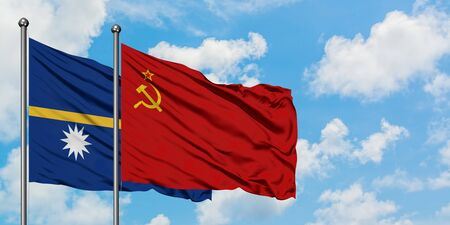 Nauru and Soviet Union flag waving in the wind against white cloudy blue sky together. Diplomacy concept, international relations.