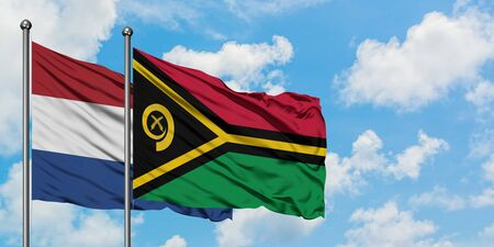 Netherlands and Vanuatu flag waving in the wind against white cloudy blue sky together. Diplomacy concept, international relations.
