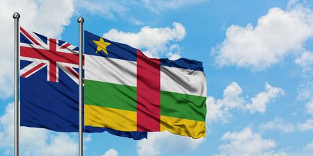New Zealand and Central African Republic flag waving in the wind against white cloudy blue sky together. Diplomacy concept, international relations.