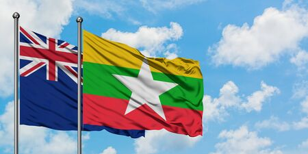 New Zealand and Myanmar flag waving in the wind against white cloudy blue sky together. Diplomacy concept, international relations. Stok Fotoğraf