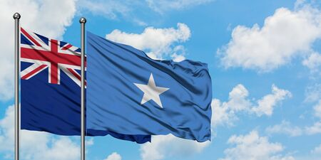 New Zealand and Somalia flag waving in the wind against white cloudy blue sky together. Diplomacy concept, international relations.