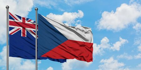 New Zealand and Czech Republic flag waving in the wind against white cloudy blue sky together. Diplomacy concept, international relations.