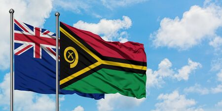 New Zealand and Vanuatu flag waving in the wind against white cloudy blue sky together. Diplomacy concept, international relations.