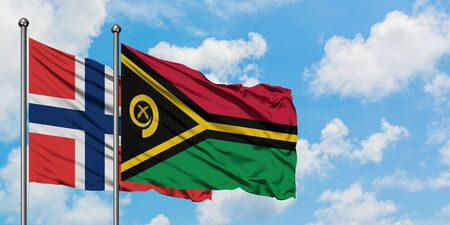 Norway and Vanuatu flag waving in the wind against white cloudy blue sky together. Diplomacy concept, international relations.