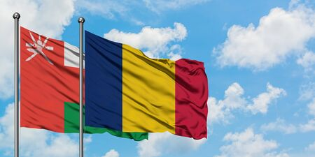Oman and Chad flag waving in the wind against white cloudy blue sky together. Diplomacy concept, international relations. Archivio Fotografico - 147337135