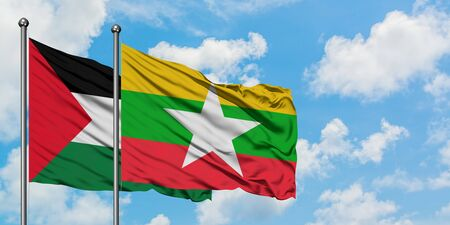 Palestine and Myanmar flag waving in the wind against white cloudy blue sky together. Diplomacy concept, international relations. Stok Fotoğraf