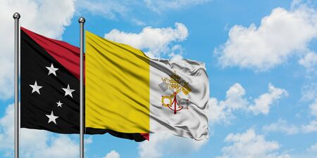Papua New Guinea and Vatican City flag waving in the wind against white cloudy blue sky together. Diplomacy concept, international relations.