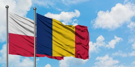 Poland and Chad flag waving in the wind against white cloudy blue sky together. Diplomacy concept, international relations.