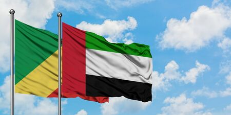Republic Of The Congo and United Arab Emirates flag waving in the wind against white cloudy blue sky together. Diplomacy concept, international relations.