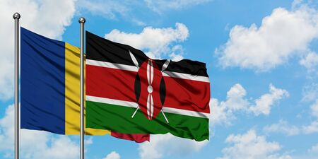 Romania and Kenya flag waving in the wind against white cloudy blue sky together. Diplomacy concept, international relations. Stock Photo