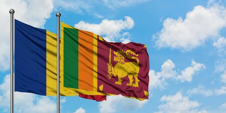 Romania and Sri Lanka flag waving in the wind against white cloudy blue sky together. Diplomacy concept, international relations. Stock Photo