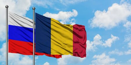 Russia and Chad flag waving in the wind against white cloudy blue sky together. Diplomacy concept, international relations.