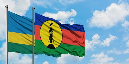 Rwanda and New Caledonia flag waving in the wind against white cloudy blue sky together. Diplomacy concept, international relations.