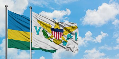 Rwanda and United States Virgin Islands flag waving in the wind against white cloudy blue sky together. Diplomacy concept, international relations.