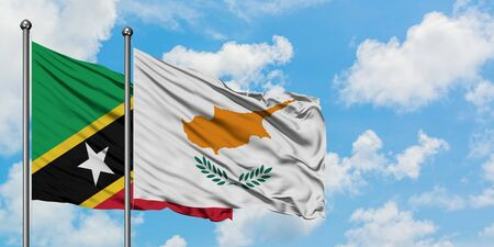 Saint Kitts And Nevis and Cyprus flag waving in the wind against white cloudy blue sky together. Diplomacy concept, international relations. Standard-Bild