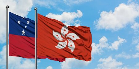 Samoa and Hong Kong flag waving in the wind against white cloudy blue sky together. Diplomacy concept, international relations.