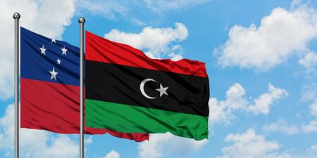 Samoa and Libya flag waving in the wind against white cloudy blue sky together. Diplomacy concept, international relations. 免版税图像