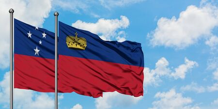 Samoa and Liechtenstein flag waving in the wind against white cloudy blue sky together. Diplomacy concept, international relations. 免版税图像
