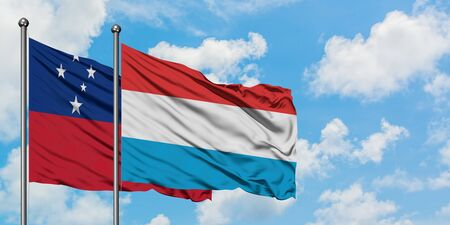 Samoa and Luxembourg flag waving in the wind against white cloudy blue sky together. Diplomacy concept, international relations.