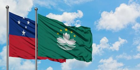 Samoa and Macao flag waving in the wind against white cloudy blue sky together. Diplomacy concept, international relations. 免版税图像