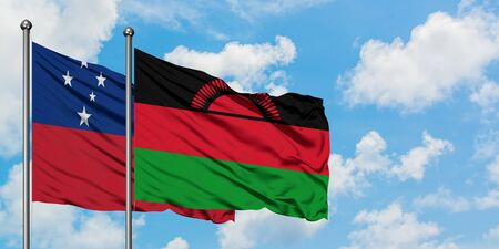 Samoa and Malawi flag waving in the wind against white cloudy blue sky together. Diplomacy concept, international relations. 免版税图像