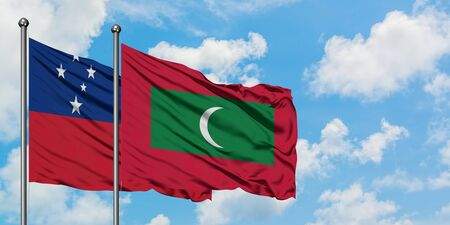 Samoa and Maldives flag waving in the wind against white cloudy blue sky together. Diplomacy concept, international relations. 免版税图像