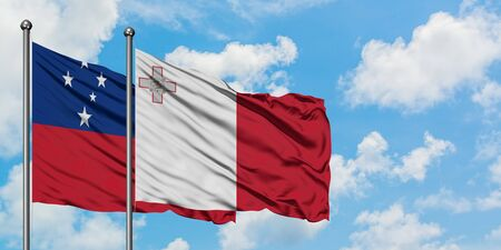 Samoa and Malta flag waving in the wind against white cloudy blue sky together. Diplomacy concept, international relations. 免版税图像