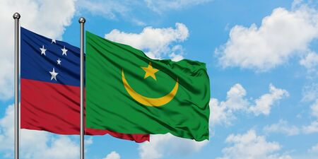 Samoa and Mauritania flag waving in the wind against white cloudy blue sky together. Diplomacy concept, international relations. 免版税图像