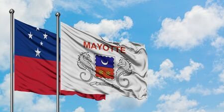 Samoa and Mayotte flag waving in the wind against white cloudy blue sky together. Diplomacy concept, international relations. 免版税图像