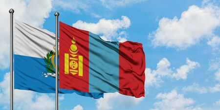 San Marino and Mongolia flag waving in the wind against white cloudy blue sky together. Diplomacy concept, international relations.