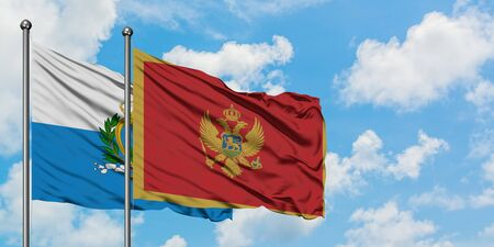 San Marino and Montenegro flag waving in the wind against white cloudy blue sky together. Diplomacy concept, international relations.