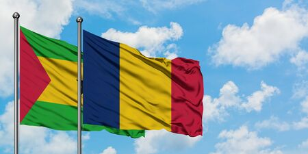 Sao Tome And Principe and Chad flag waving in the wind against white cloudy blue sky together. Diplomacy concept, international relations.