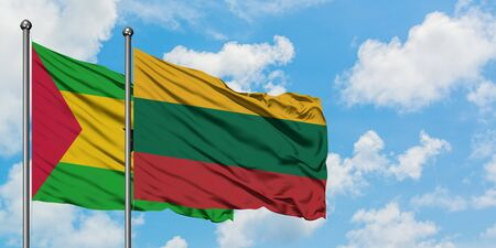 Sao Tome And Principe and Lithuania flag waving in the wind against white cloudy blue sky together. Diplomacy concept, international relations. Stock Photo