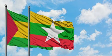 Sao Tome And Principe and Myanmar flag waving in the wind against white cloudy blue sky together. Diplomacy concept, international relations.