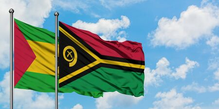 Sao Tome And Principe and Vanuatu flag waving in the wind against white cloudy blue sky together. Diplomacy concept, international relations.