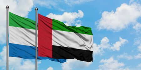 Sierra Leone and United Arab Emirates flag waving in the wind against white cloudy blue sky together. Diplomacy concept, international relations. Фото со стока