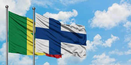 Senegal and Finland flag waving in the wind against white cloudy blue sky together. Diplomacy concept, international relations. 스톡 콘텐츠