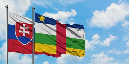 Slovakia and Central African Republic flag waving in the wind against white cloudy blue sky together. Diplomacy concept, international relations. Фото со стока