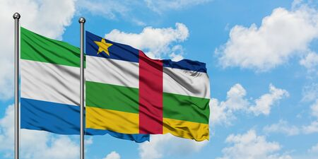 Sierra Leone and Central African Republic flag waving in the wind against white cloudy blue sky together. Diplomacy concept, international relations. Фото со стока