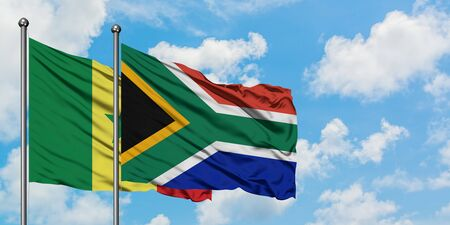 Senegal and South Africa flag waving in the wind against white cloudy blue sky together. Diplomacy concept, international relations.