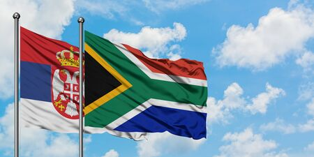 Serbia and South Africa flag waving in the wind against white cloudy blue sky together. Diplomacy concept, international relations. 스톡 콘텐츠